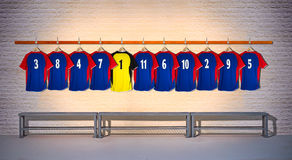 Row of Blue and Yellow Football Shirts Stock Photo