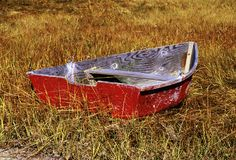 Row boat. Old row boat in marsh grass. Autumn, Cape Cod, MA Royalty Free Stock Images