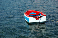 Row boat. Tied colorful row boat stock images