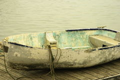 Row boat. An old row boat laying on a wooden dock Stock Photography