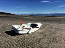 Row boat beach. Boat on sandy beach Royalty Free Stock Images