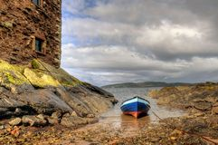 Row Boat and Castle. Landscape of a row boat moored beside a castle in Scotland Stock Photography