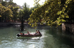 A row boat circles Ayn-i Zeliha (sacred pool) in the Golbasi section of Urfa (Sanliurfa) in eastern Turkey. Stock Photo