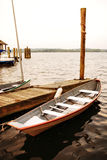 Row boat at the dock. A row boat tied to the dock in a river stock photography