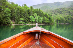 Row boat floating on green water of the glacial Biograd lake. Montenegro, Europe Stock Images