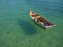 Row boat floating on the water. Small row boat floating on the water royalty free stock photography