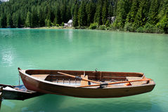 Row boat floating on the water Stock Photos