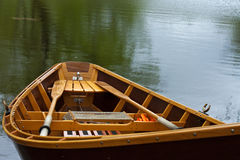 Row Boat on Lake. Row boat on the shore of a pond Stock Photo