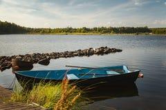 Row boat by lake Stock Photo