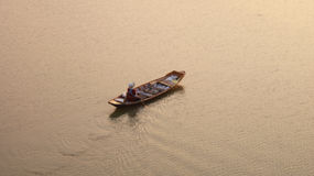 Row boat with monger. The monger is on a row boat in the choapaya river thailand royalty free stock images