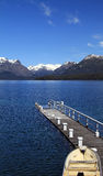 Row Boat on the Pier. A row boat at a pear in Patagonia Stock Photo