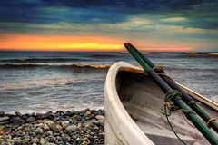 Row boat at Playa Waikiki in Lima, Peru at sunset Royalty Free Stock Image