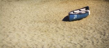 Row boat on the sand. Blue row boat on the sand.Perfect for your project ,where you need lovely background with marine motif stock image