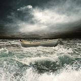 Row boat in thrunderstorm Royalty Free Stock Image