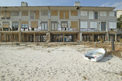 Row boat and waterfront house hit  by Hurricane Royalty Free Stock Photo