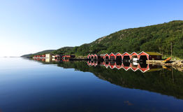 Row of boathouses in Scandinavia Royalty Free Stock Photos