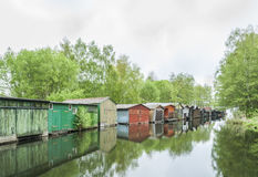 Row of boathouses in Wustrow Stock Photo