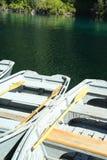 Row boats. Rental row boats tied to the dock on a cascade  lake Stock Photography