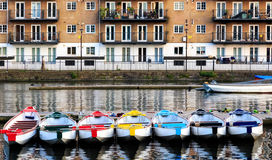 Row of Boats Decorated with Different Colours Royalty Free Stock Photography
