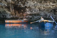 Row boats used to conduct tours inside the Melissani Lake Cave Kefalonia. Row boats and guide used to conduct tours inside the Melissani Lake Cave Kefalonia Royalty Free Stock Photography