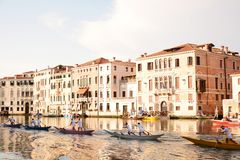 Row of boats and Regata Storica, Venice, Italy. Row of boats on Grand Canal training for Regata Storica event in Venice, Italy, Europe Royalty Free Stock Photos