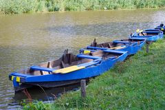 A row of boats by the river in the morning royalty free stock photography