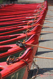 Row of boats with ropes and locks. View of many rowing boats, taken on the bank of river Nidd in bright summer sunlight in the mother Shipton park, Knaresborough Stock Images