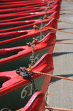 Row of boats with ropes and locks. View of many rowing boats, taken on the bank of river Nidd in bright summer sunlight in the mother Shipton park, Knaresborough Stock Photography