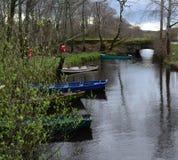 Row Boats and Skiffs in Killarney National Park. Colorful row boats and skiffs in Killarney National Park stock photo