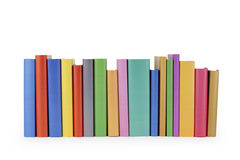 Row of books. A row of books with colored spines, isolated on white background Royalty Free Stock Photography