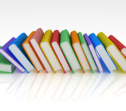 Row of Books. Sideways colourful row of hardcover books. 3D render, Isolated on White Background Stock Photo