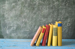Row of books, blackboard Royalty Free Stock Image
