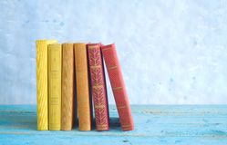 Row of books,blue background Stock Photos