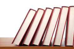 Row of books falling in sequence Stock Images