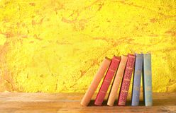 Row of books. Grungy background, free copy space Stock Images
