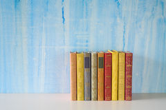 Row of books on grungy background Stock Photography