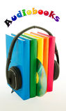 Row of books and headphones - Audiobooks concept Stock Photography
