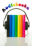 Row of books and headphones - Audiobooks concept Stock Images