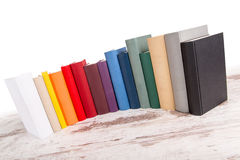 Row of books. Isolated row of different books in different colors Royalty Free Stock Photos