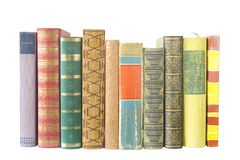 Row of books isolated. Row of old multicolred books isolated on white background stock photo