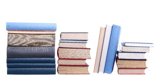 Row of books isolated on white background, with clipping path Royalty Free Stock Photo