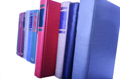 Row of books lined up in row Stock Photo