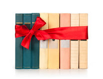 Row books with ribbon like a gift i Royalty Free Stock Image