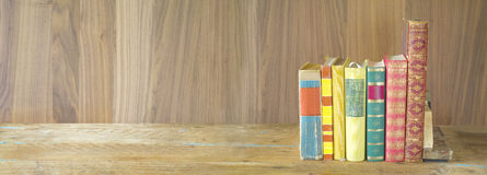 Row of books on wooden background, panorama format, good copy sp. Ace stock images