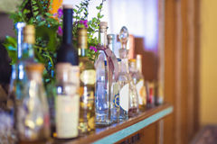 Row of Bottles With Alcohol In a Restaurant Royalty Free Stock Images