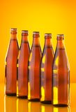 Row of bottles with beer Stock Photo