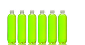 Row of bottles with green beverage. Row of bottles with a green beverage Stock Photos