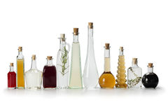 Row of bottles with vinegar. Row of bottles with homemade organic vinegar on white background Royalty Free Stock Image