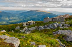 Row of boulders on the hillside. Lovely view from Runa mountain, Ukraine. cloudy august morning royalty free stock photos