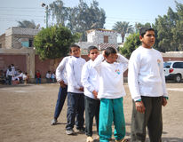 Row of boys in Egypt. Group of boys playing soccer in street near school and having fun playing and doing activities together and helping each other, photo was Stock Image